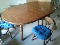 Maple Dining Room Table with 4 chairs and 2 leaves.