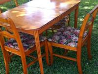 Maple dining room table and 4 chairs. Great condition.