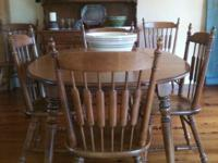 Beautiful hard rock maple dining table with six chairs.