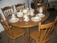 Very nice maple dining table w/6 chairs and 2 leaves.