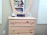 Maple in color...older dresser with mirror top. This is