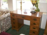 Nice compact hardwood student desk. 43 inches broad by