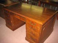 This is a very nice maple desk with 8 drawers including