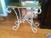 I have a wrought iron black marble top table that the