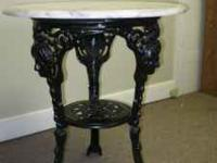 This beautiful replica has a white marble top and black