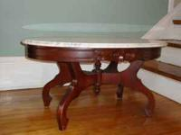 "I am selling 2 marble top tables, 1 round 22"" in"