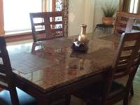 Im selling my table. Its solid wood with marble top.