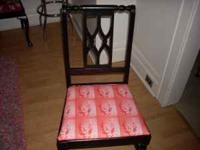 Glossy black chair with hot pink marilyn monroe fabric,