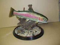 Beautiful trout hand made and mounted onto small stand.