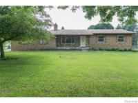 BEAUTIFULLY UPDATED RANCH SITTING ON A NICE TREED.83