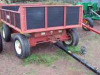 FOR SALE LIKE NEW HYDRAULIC DUMP FARM WAGON. THIS WAGON