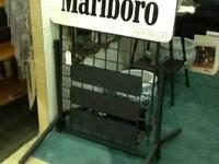 Two sided metal Marlboro sign .Has its original stand