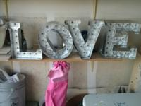 Aluminum light-up LOVE marquee sign for sale. Each
