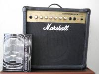 MARSHALL MG100HDFX HALFSTACK W CELESTION SPEAKERS.