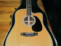 Utilized Martin DC Aura acoustic electric guitar in