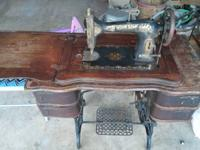 Antique Mason Rotary sewing device still in cabinet.