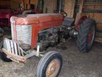 Good old running tractor. Starts & runs well--does not