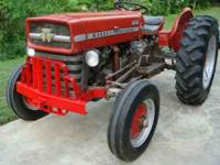 THIS IS A MASSEY FERGUSON TRACTOR MODEL 135 WITH A