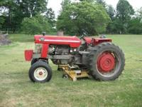 "Massey Ferguson 180 deisel with attached 72"" Woods"