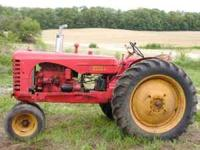 1952 Massey Harris 44, gas, one remote, rear tires 90%,