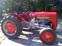 This is my husband's tractor which he rebuilt with a