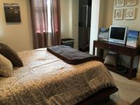 Master bedroom furnished with Tv, large walk in closet