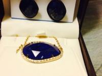 "Dark blue stone with ""gold"" flashes woven thought and"