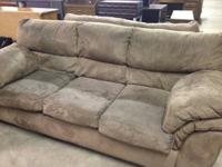 Matching light brown microfiber couch an loveseat. The