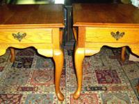 Available is a nice matching pair of oak Broyhill end