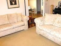 Matching off white/ivory jacquard sofa and loveseat.