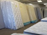 Liquidating excess bed mattress sets for a top name
