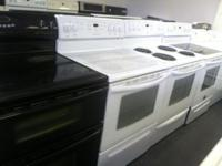 a nice black maytag double oven. a smaller sized oven