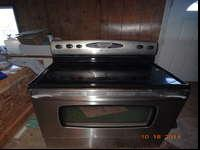 We have a Maytag Electric range. It has a glass top