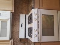 Maytag Gas Range T1 with overhead matching Microwave