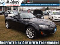 Grand Touring Soft Top 6 Speed Manual Leather Heated