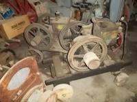 2) Old McCormick Deering 1 1/2 hp Gas Engines. Both are