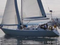 """Relentless"" is a 44 foot cutter rigged sailboat. She"