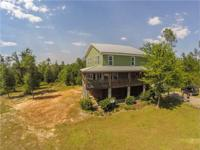 This property is secluded in the woods down a private