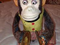 A cymbal-banging monkey toy is a mechanical depiction