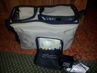 Medela Double Breast pump orginally $279.99 in bag .