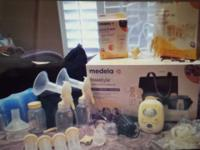 Medela-Like New. I am selling my Electric Breast pump