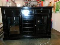This media console has a stylish / distressed black