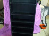TALL BLACK WOOD MEDIA/DVD STORAGE STAND. IT HAS