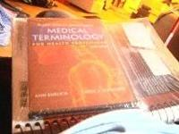 still in wrap sixth edition medical terminology book