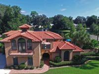 This meticulously maintained Mediterranean-style home