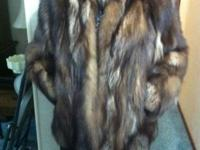 Medium brown fox coat. Size not listed however owner