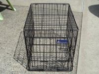 Up for sale is a medium used dog Crate. It's clean and