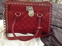 this is a pretty quilted Michael kors bag with a silver