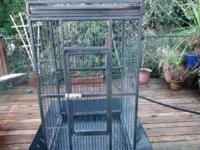 WE HAVE A NICE USED MEDIUM SIZE PARROT CAGE UP FOR