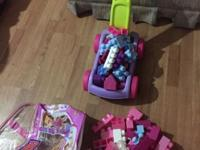 I have a bag full of mega blocks pink purple white.